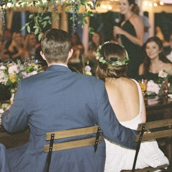 Bride and groom listen to toasts at their fall reception at Morning Glory Farms captured by Maggie Colleta Photography