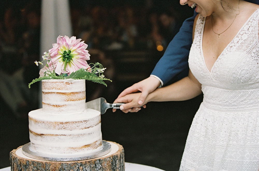 Bride and groom cut a naked cake from Publix Bakery at their fall wedding at Morning Glory Farms coordinated by Magnificent Moments Weddings
