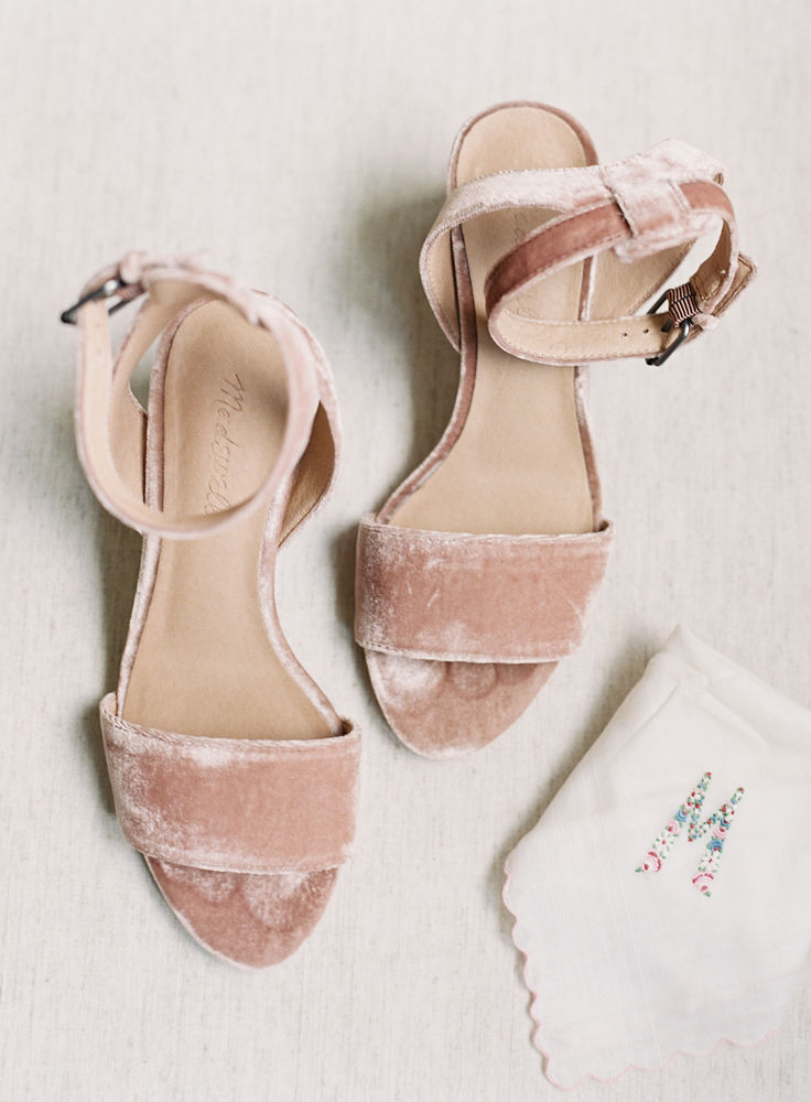 Soft pink velvet bridal shoes are captured in a detail shot by Maggie Colleta Photography