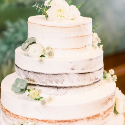 Publix cake has a simple white design accented by greenery and captured by Maggie Mills Photography