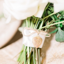 Bridal bouquet features a meaningful heart locket created and designed by Narcisse Greenway Designs and captured by Maggie Mills Photography