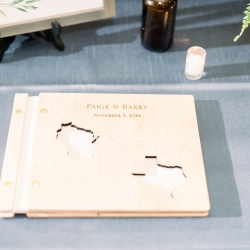 Custom guestbook features the home states of the bride and groom captured by Maggie Mills Photography