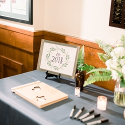 Guestbook tables features custom sign showing the couples new anniversary designed by Magnificent Moments Weddings