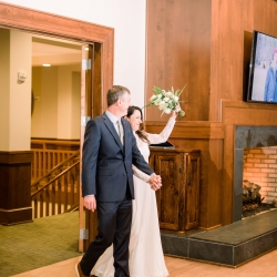 Bride and groom enter into their wedding reception at Old Providence Country Club during their wedding reception coordinated by Magnificent Moments Weddings