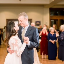 Bride and groom share a special dance during their wedding reception captured by Maggie Mills Photography