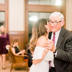 Bride shares a dance with her father during her intimate wedding reception at Old Providence Racquet Club