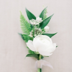 Simple white boutonniere designed by Narcisse Greenway Designs for an intimate wedding on Lake Tillery