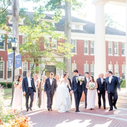 Bride and groom walk with their bridal party to their wedding ceremony at Belk Chapel captured by More Beatty Photography
