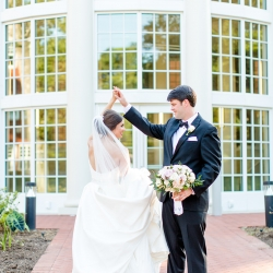 Groom twirls his bride and holds her stunning boquet by Chelish Moore all captured by More Beatty Photography
