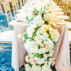 Lush overflowing flower centerpieces by Chelish Moore were the perfect accent to a summer wedding at Providence Country Club coordinated by Magnificent Moments Weddings