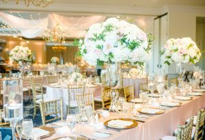 Stunning floral centerpieces from Chelish Moore are the perfect accent for a elegant wedding at Providence Country Club