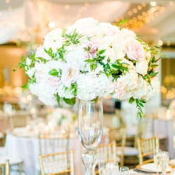 Chelish Moore created over the top floral centerpieces with lush hydrangeas and soft pink roses for a summer wedding at Providence Country Clubd