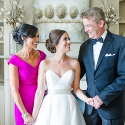 Bride shares a sweet moment with her parents before her wedding at Providence Country Club captured by More Beatty Photography