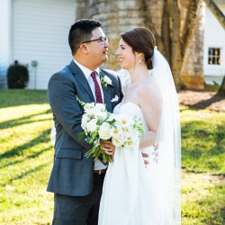 Bride and groom pose for Nhieu Tang Photography during their fall wedding coordinated by Magnificent Moments Weddings