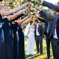 Bride and groom share a fun moment with their bridal party captured by Nhieu Tang Photography
