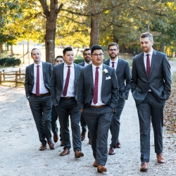 Groom poses with groomsment for Nhieu Tang Photography during his fall wedding at The Dairy Barn
