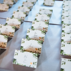 Escort cards featured greenery accents and are the perfect subject for Nhieu Tang Photography