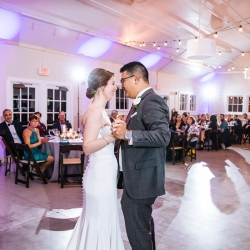 Bride and groom share a sweet first dance to music provided by Raise the Roof
