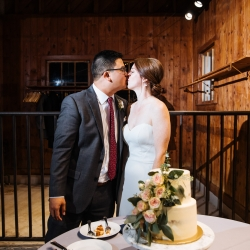 Bride and groom share a sweet kiss captured by Nhieu Tang Photography