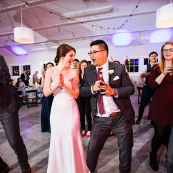 Bride and groom share the dance floor with guests to music provided by Raise the Roof