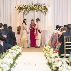 Bride and groom exchange vows during an Indian infused wedding ceremony at The Westin Hotel