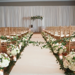 Stunning floral pieces lined the aisle created by Lily Greenthumbs for a summer wedding at The Westin Hotel