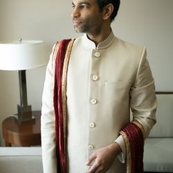 Groom poses for Old South Studios before his Indian infused wedding coordinated by Magnificent Moments Weddings