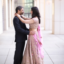 Bride and groom share a sweet moment in Uptown Charlotte as they prepare for their Indian infused wedding coordinated by Magnificent Moments Weddings