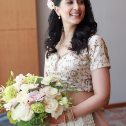 Bride shows of her traditional Indian gown for her wedding coordinated by Magnificent Moments Weddings