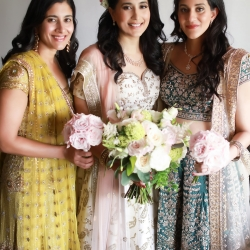 Bride poses with family during her Indian infused wedding in Uptown Charlotte