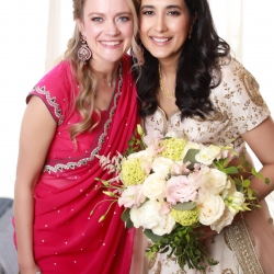 Bride poses with a friend showing off their Indian clothing during their infused wedding at The Westin
