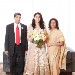 Bride poses with her parents before her wedding at The Westin in Uptown Charlotte