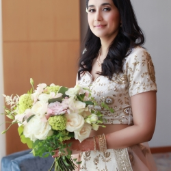 Bride shows off her stunning floral bouquet created by Lily Greenthumbs for her Uptown Charlotte wedding