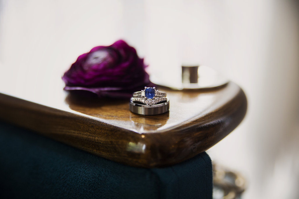 Detail shot of bridal rings captured by Paper Heart Studios for a spring wedding in Uptown Charlotte