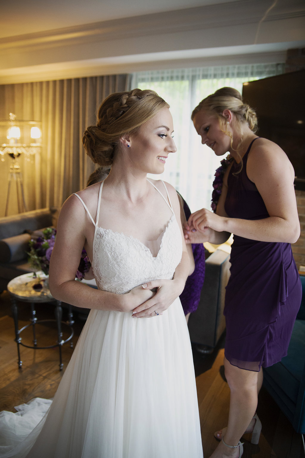 Bride getting ready with bridesmaids while getting hair and makeup by The Beauty Fairy