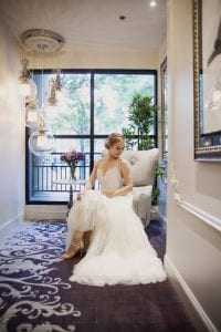 Bride poses for bridal portrait before her spring wedding at Foundation for the Carolinas