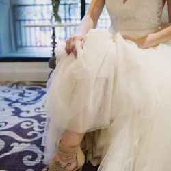 Bride shows off her bridal shoes before her wedding at Foundation for the Carolinas