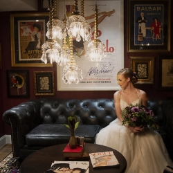 Bride poses for portrait captured by Paper Heart Photography before her spring wedding in Uptown Charlotte