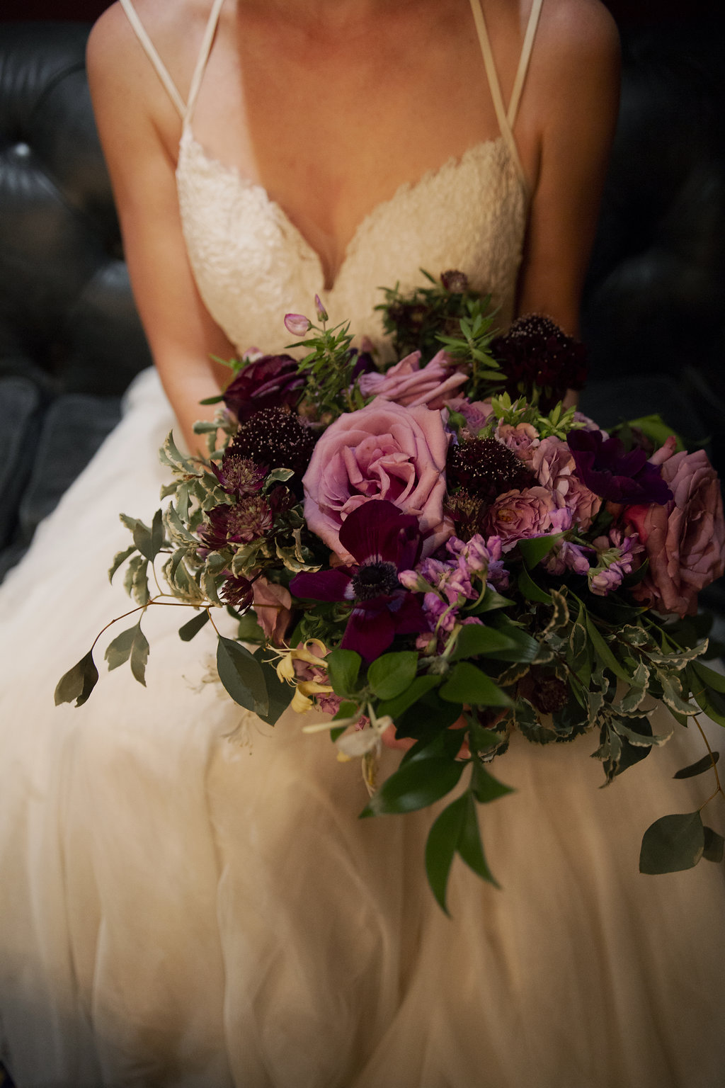Amazing bridal bouquet by Whats Up Buttercup features purple roses and soft greenery