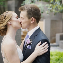 Paper Heart Studios captures a bride and groom kissing during their spring wedding at Foundation for the Carolinas