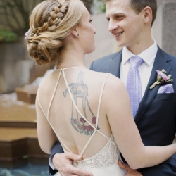 Bride and groom embrace during their spring wedding in Uptown Charlotte captured by Paper Heart Photography