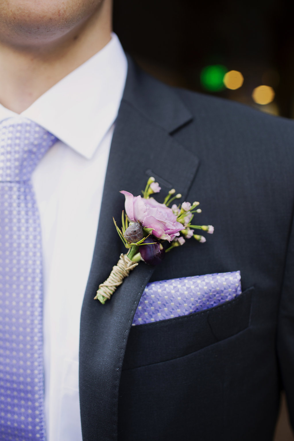 Detail shot of grooms boutineer created by Whats Up Buttercup for a spring wedding in Uptown Charlotte