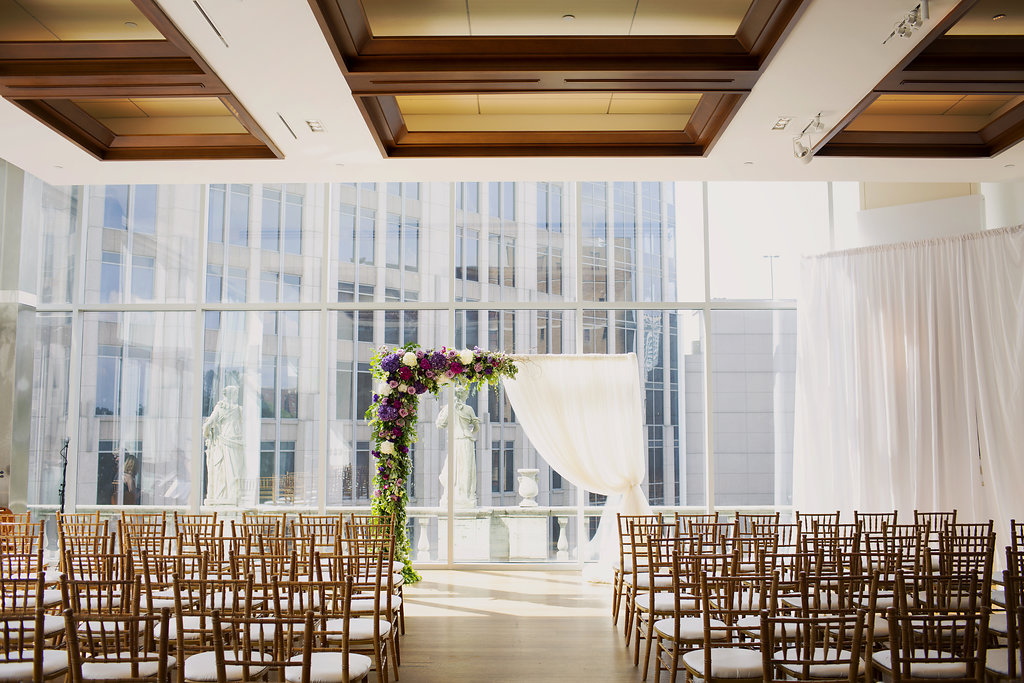Ceremony space at Foundation for the Carolinas for a spring wedding captured by Paper Hearts Photography and coordinated by Magnificent Moments Weddings