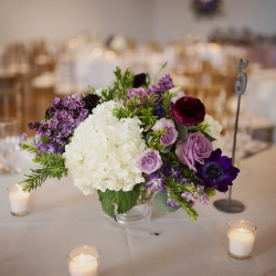 Small floral centerpiece of white hydrangeas and purple flowers created by Whats Up Buttercup for a wedding at Foundation for the Carolinas