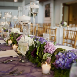 Paper Heart Photography captures tablescapes for a Foundation for the Carolinas wedding featuring lavender linens, deep purple florals, and elegant candle light