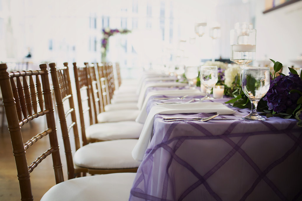 Gold chiavari chairs and lavender linens from Party Reflections create an elegant tone for a spring wedding at Foundations for the Carolinas coordinated by Magnificent Moments Weddings