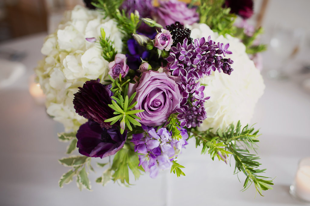 Bridal bouquet including amazing lavender roses and white hydrangeas created by Whats Up Buttercup for a wedding at Foundation for the Carolinas