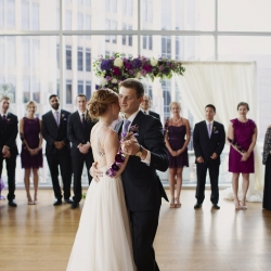 Bride and groom share a first dance to music provided by Huskey AMA during their wedding reception coordinated by Magnificent Moments Weddings