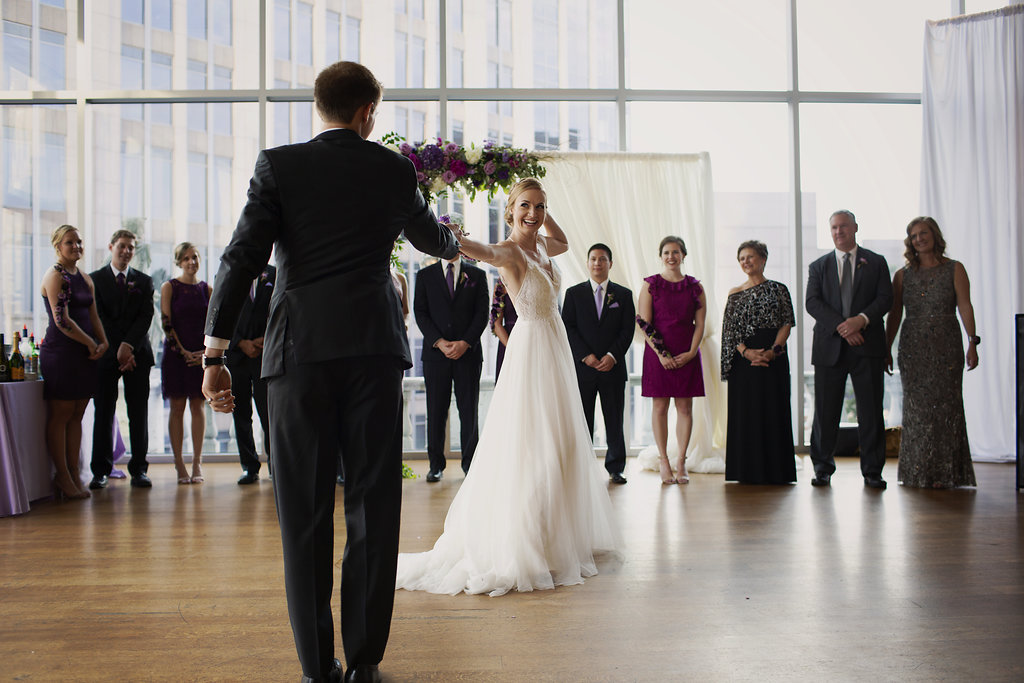 Bride and groom dance to music by Huskey AMA at their Uptown Charlotte wedding reception captured by Paper Hearts Photography