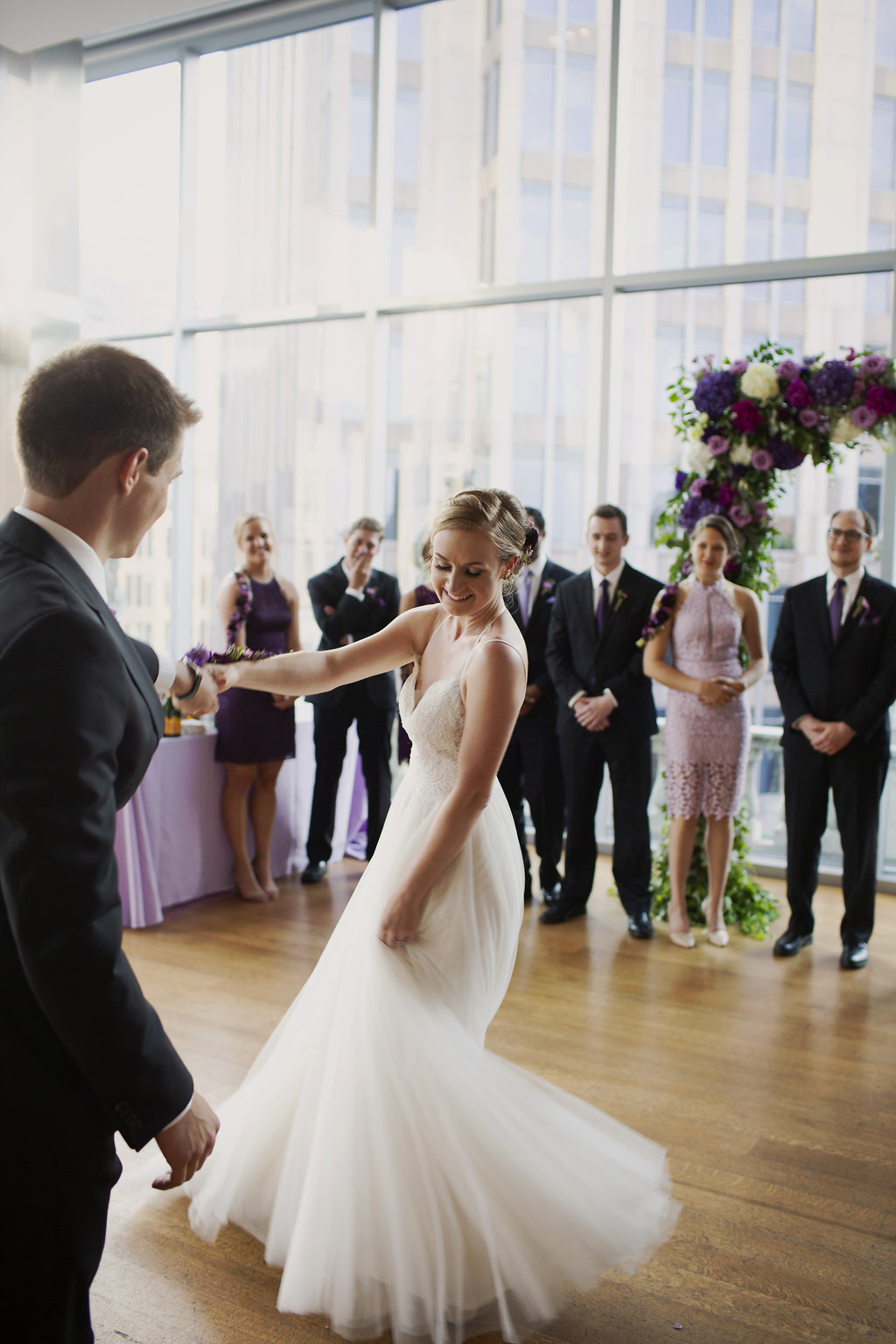 Bride is spinning to music by Huskey AMA during her wedding reception coordinated by Magnificent Moments Weddings